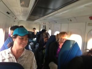 Kristy Allan and climbers on the plane