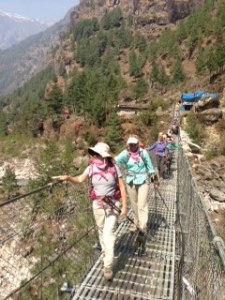 The ladies crossing the river on a really high bridge on the way to Namche